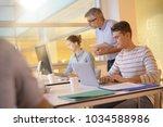teacher with students in...   Shutterstock . vector #1034588986