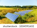 solar panels on the farm. solar ... | Shutterstock . vector #1034591632