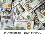 usd 100 dollars  many standing... | Shutterstock . vector #1034594902
