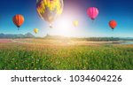colorful balloons in the blue... | Shutterstock . vector #1034604226