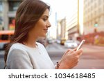 close up on woman hands holding ... | Shutterstock . vector #1034618485