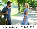 Small photo of Love at first sight concept. Man and woman likes each other. Casual encounter, meet on sunny summer day, nature background, defocused. Man with beard and blonde girl stopped to get acquainted.