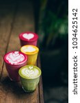trendy multicolored lattes.... | Shutterstock . vector #1034625142