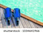 blue fins for diving on a... | Shutterstock . vector #1034641966