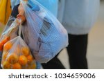 people are carrying plastic... | Shutterstock . vector #1034659006