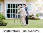 elderly woman exercise walking... | Shutterstock . vector #1034664898