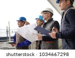 instructor with young people in ... | Shutterstock . vector #1034667298