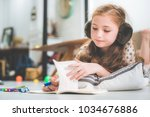 little cute girl studying and... | Shutterstock . vector #1034676886