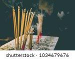 incense sticks until burning... | Shutterstock . vector #1034679676