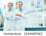 scientists in laboratory.... | Shutterstock . vector #1034685562
