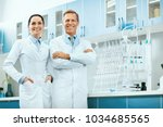 scientists in laboratory.... | Shutterstock . vector #1034685565