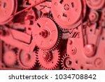 red gears and cogs macro shot ... | Shutterstock . vector #1034708842