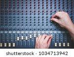 male sound engineer hands... | Shutterstock . vector #1034713942