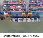container ship in export and... | Shutterstock . vector #1034715052