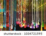 threads of colored beads with... | Shutterstock . vector #1034721595