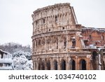 a lovely day of snow in rome ... | Shutterstock . vector #1034740102