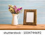 vintage flowers and photo frame ... | Shutterstock . vector #1034744692