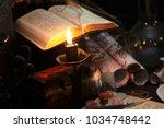 antique magic book. witchcraft  ... | Shutterstock . vector #1034748442