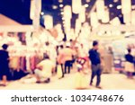 blurred image of shopping mall...   Shutterstock . vector #1034748676