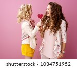 pink mood. happy stylish mother ...   Shutterstock . vector #1034751952