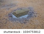 reflection in a puddle.... | Shutterstock . vector #1034753812