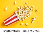 popcorn in a red and white... | Shutterstock . vector #1034759758