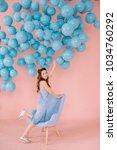 a sexy little girl in a blue...   Shutterstock . vector #1034760292