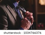 a man in a tailor shop and... | Shutterstock . vector #1034766376