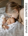 blonde little girl and 1 month... | Shutterstock . vector #1034782012
