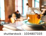 tasty honey in a glass jar with ... | Shutterstock . vector #1034807335