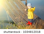 Young Little Boy Fishing From...