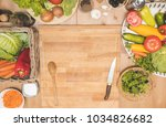 vegetables on a wooden table...   Shutterstock . vector #1034826682