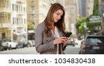 cute businesswoman intern using ... | Shutterstock . vector #1034830438
