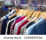 fashionable clothes on hangers... | Shutterstock . vector #1034834536