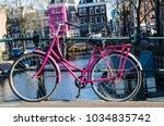 pink bicycle in amsterdam at... | Shutterstock . vector #1034835742