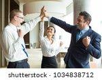 happy team giving hi five after ... | Shutterstock . vector #1034838712