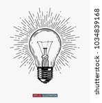 hand drawn light bulb. vintage... | Shutterstock .eps vector #1034839168
