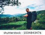 pensive bearded tourist with... | Shutterstock . vector #1034843476