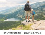 father and son traveling in... | Shutterstock . vector #1034857936