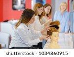wigs on mannequin heads   Shutterstock . vector #1034860915