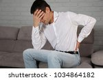 man suffering from back pain....   Shutterstock . vector #1034864182