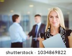portrait of young businesswoman ... | Shutterstock . vector #1034869822
