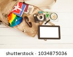 travel concept with suitcase   Shutterstock . vector #1034875036