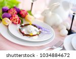 beautiful table setting with... | Shutterstock . vector #1034884672
