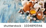 chicken eggs and almond flowers ... | Shutterstock . vector #1034890546