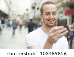 young man with mobile phone... | Shutterstock . vector #103489856