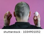 hairless man with easter eggs... | Shutterstock . vector #1034901052