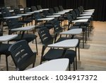empty chairs in conference room | Shutterstock . vector #1034917372