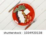 fresh greek feta cheese... | Shutterstock . vector #1034920138