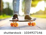 hipster girl with skateboard... | Shutterstock . vector #1034927146